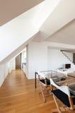 Interior, new loft. Interior, beautiful loft, hardwood floor, dining table Stock Image
