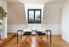 Interior, new loft. Interior, beautiful loft, hardwood floor, dining table Stock Photos