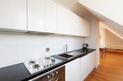 Interior, new loft. Interior, beautiful loft, hardwood floor, modern kitchen Stock Photography