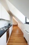 Interior, new loft. Interior, beautiful loft, hardwood floor, modern kitchen Stock Photo
