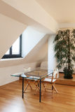 Interior, new loft. Interior, beautiful loft, hardwood floor, view dining table Royalty Free Stock Photography