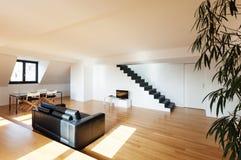 Interior, new loft. Interior, beautiful loft, hardwood floor, view living room Royalty Free Stock Photography