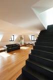 Interior, new loft. Interior, beautiful loft, hardwood floor, view staircase black Royalty Free Stock Images
