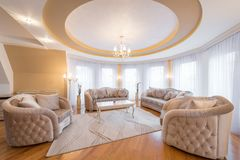 Interior of a luxury living room with round, circle, ceiling. Interior of a new luxury living room with round, circle, ceiling stock photography
