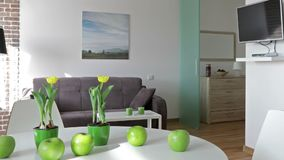 Interior of a new modern apartment in scandinavian style. Motion panoramic view stock footage
