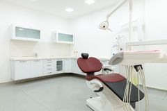 Interior of new modern dental clinic office room. Dentistry, stomatology, medical equipment concept in dental cabinet stock photos