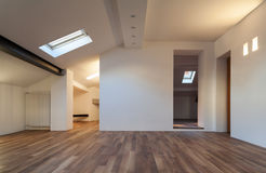 Interior nice loft. Wall white, parquet floor Royalty Free Stock Photos