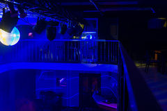 Interior of Night Club Lit with Blue Lights Royalty Free Stock Photos