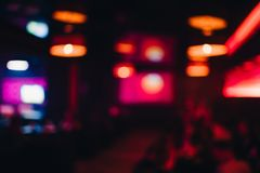 Interior of night club with a lubricated and blurred background with. Bokeh from bright lights Royalty Free Stock Images