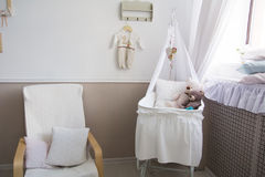 Interior of a nursery with a crib for a baby. royalty free stock photo