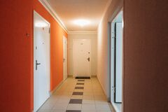 Free Interior Of A Residential Building In White And Orange Colors With Entrance Doors Stock Photography - 178581902
