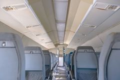 Interior Of An Airplane With Many Seats Royalty Free Stock Image