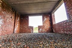 Interior Of An Old Building Under Construction. Orange Brick Walls In A New House. Stock Photos