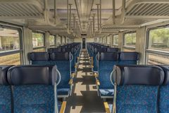 Free Interior Of Blue Train With Blue Seat And Wooden Armrest Stock Photos - 133952693