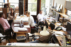 Interior Of Busy Architect S Office With Staff Working Stock Images