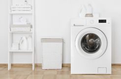 Interior Of Home Laundry Room With Washing Machine Near Wall Stock Image