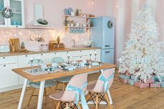 Free Interior Of Modern White Kitchen With Pink Walls And Blue Decor On A Christmas New Year Eve. Pine Tree With Wrapped Gifts And Royalty Free Stock Photos - 163775928