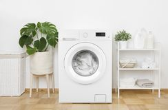 Free Interior Of Pastel Colors Laundry Room With Modern Washing Machine Royalty Free Stock Photos - 166563228