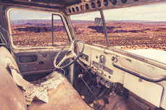 The interior of an off-road car wreck in the desert in Arizona Royalty Free Stock Photo