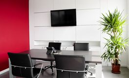 Interior office building. With furniture and a red wall