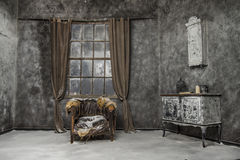 Interior of old abandoned house. Interior of old medieval abandoned house with broken armchair royalty free stock photo