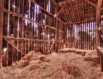 Interior of old barn with straw bales Stock Image