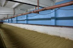 Inside the old malt house. The interior of an old brewery room for drying fresh malt royalty free stock images