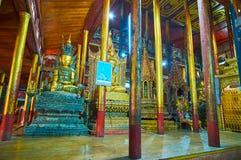 Interior of old Buddhist Monastery on Inle Lake, Myanmar. YWAMA, MYANMAR - FEBRUARY 18, 2018: Interior of historical Nga Phe Chaung Monastery of jumping cats Stock Photo
