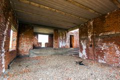 Interior of an old building under construction. Orange brick walls in a new house. royalty free stock photo