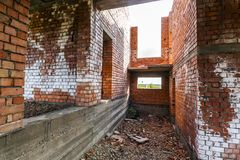 Interior of an old building under construction. Orange brick walls in a new house. stock photo