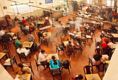 Interior of old cafe near the indian university with relaxing people Royalty Free Stock Images