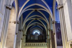 Interior of the old christian church. Interior of the old christian roman catholic church build in gothic style with blue ceiling with stars representing heaven royalty free stock photography
