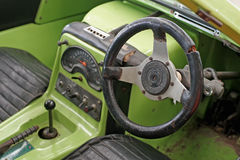 Interior of old classic car with steering wheel and dashboard Royalty Free Stock Photography