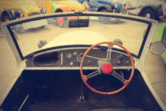 Interior of old classic vintage car. (Filtered image processed vintage effect stock image