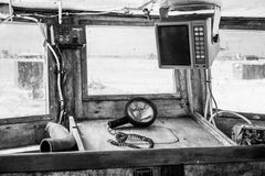 Interior of an old cockpit on a fishing boat Stock Images