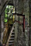 Interior of old factory building. With metal staircase and window Royalty Free Stock Photography
