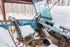 Interior of old forgotten broken car in snowy winter royalty free stock image