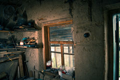 Interior old instrumental in the village with various instruments. Royalty Free Stock Images