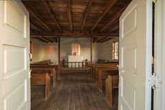 Interior of an small old country Norwegian church. Doors opening into the interior of an early 1800`s Norwegian country church built in America Stock Photo