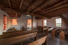 Interior of an small old country Norwegian church. The interior of an early 1800`s Norwegian country church built in America by immigrants by farmers in the Stock Image