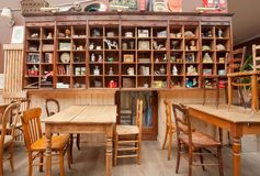 Interior of old restaurant with vintage decor, wooden furniture and retro details inside Stock Photos