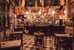 Interior of old restaurant with vintage style decoration waiting for customers and hungry tourists stock photos