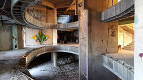 Interior of an old ruined hotel. Round hall royalty free stock photos