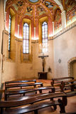 Interior of old small catholic church Stock Photos