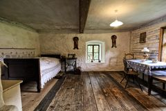 Interior of the old village house. Interior of the old Bohemian village house with wooden floor Royalty Free Stock Photo