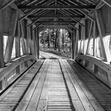 Interior of an old vintage covered wooden bridge Stock Image