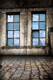 Interior of Old Warehouse Background. Inside an old warehouse. Looking towards backlit windows as a background Stock Photos