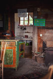 Interior of an Old Wooden Serbian House. Details of an interior of an old wooden Serbian house, everything is handmade from furniture to walls stock image