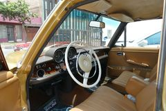 Interior of an oldtimer Mercedes-Benz 280SE in Lima. Lima, Peru. February 21, 2018.  Retro styled image of an oldtimer automatic Mercedes-Benz 280SE sedan Royalty Free Stock Photography