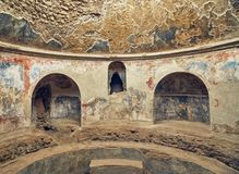 Interior of Stabian Baths Pompeii, Italy. Interior of one of the bathrooms in Stabian Baths Pompeii, Italy with partially preserved frescoes stock photo